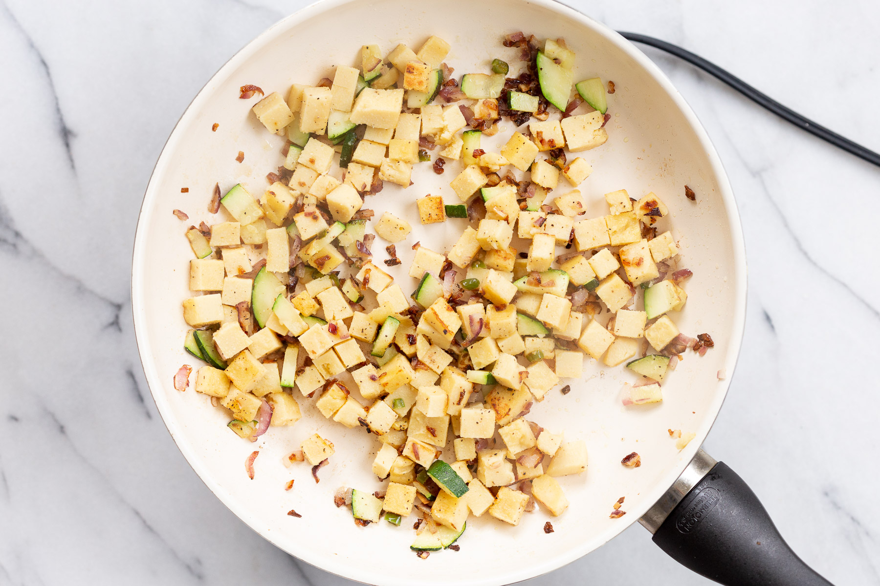Cubes Chickpea Tofu on a white skillet