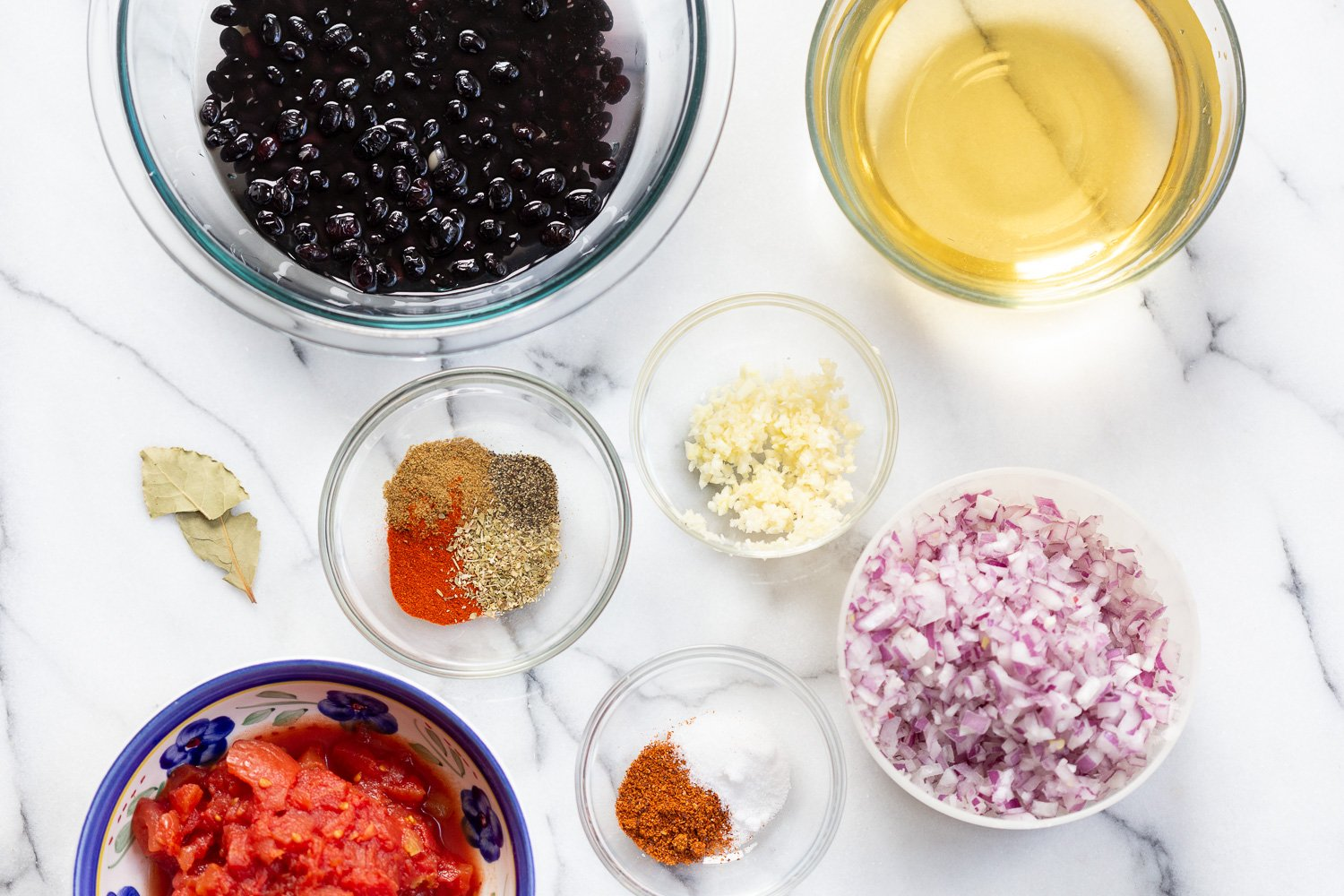 overhead shot of all ingredients needed for making vegan black bean soup in an Instant Pot