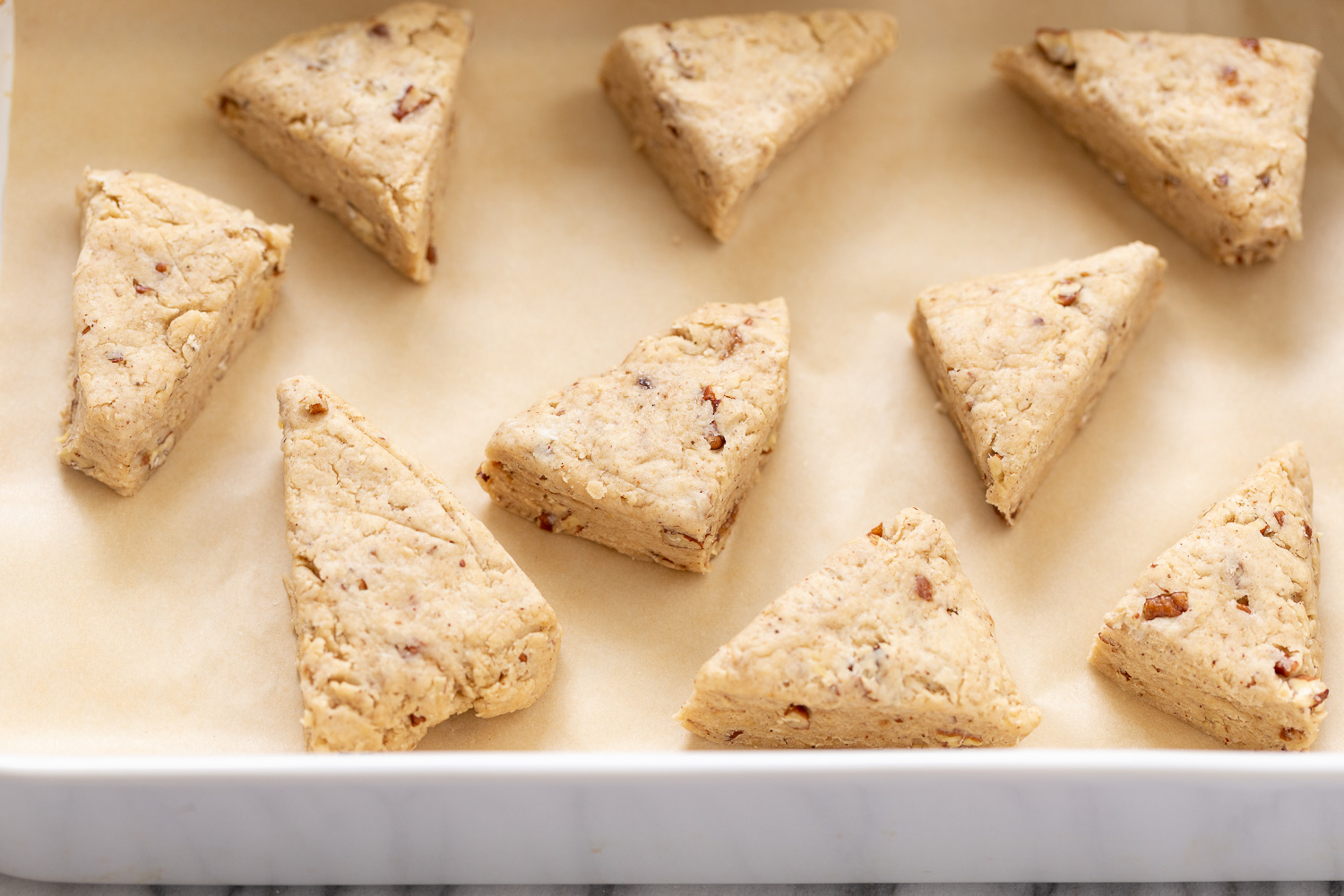 vegan banana scones on a cookie sheet lined with parchment paper