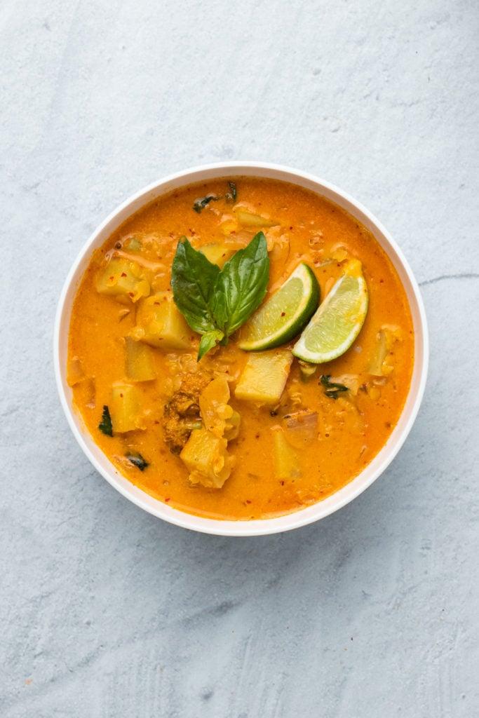 overhead shot of a creamy vegan red lentil sweet potato curry