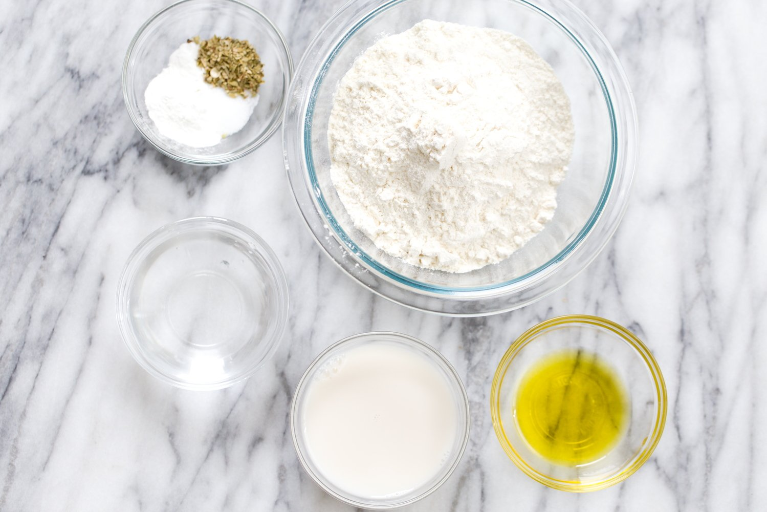 overhead shot of ingredients used for making vegan yeast-free pizza dough