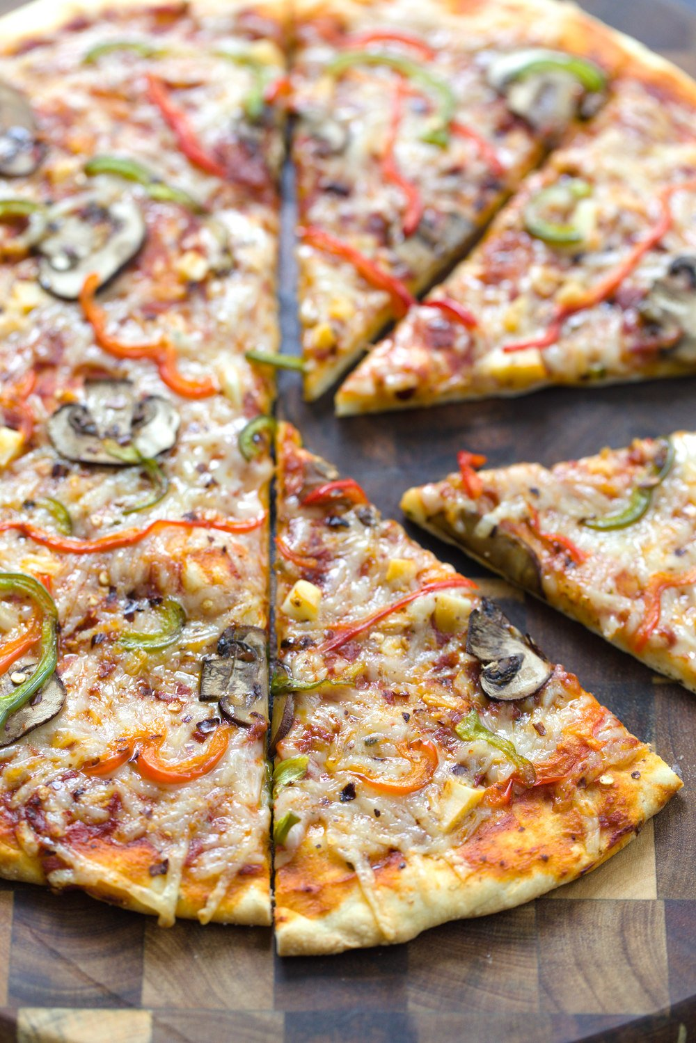 a no yeast vegan pizza cut into slices