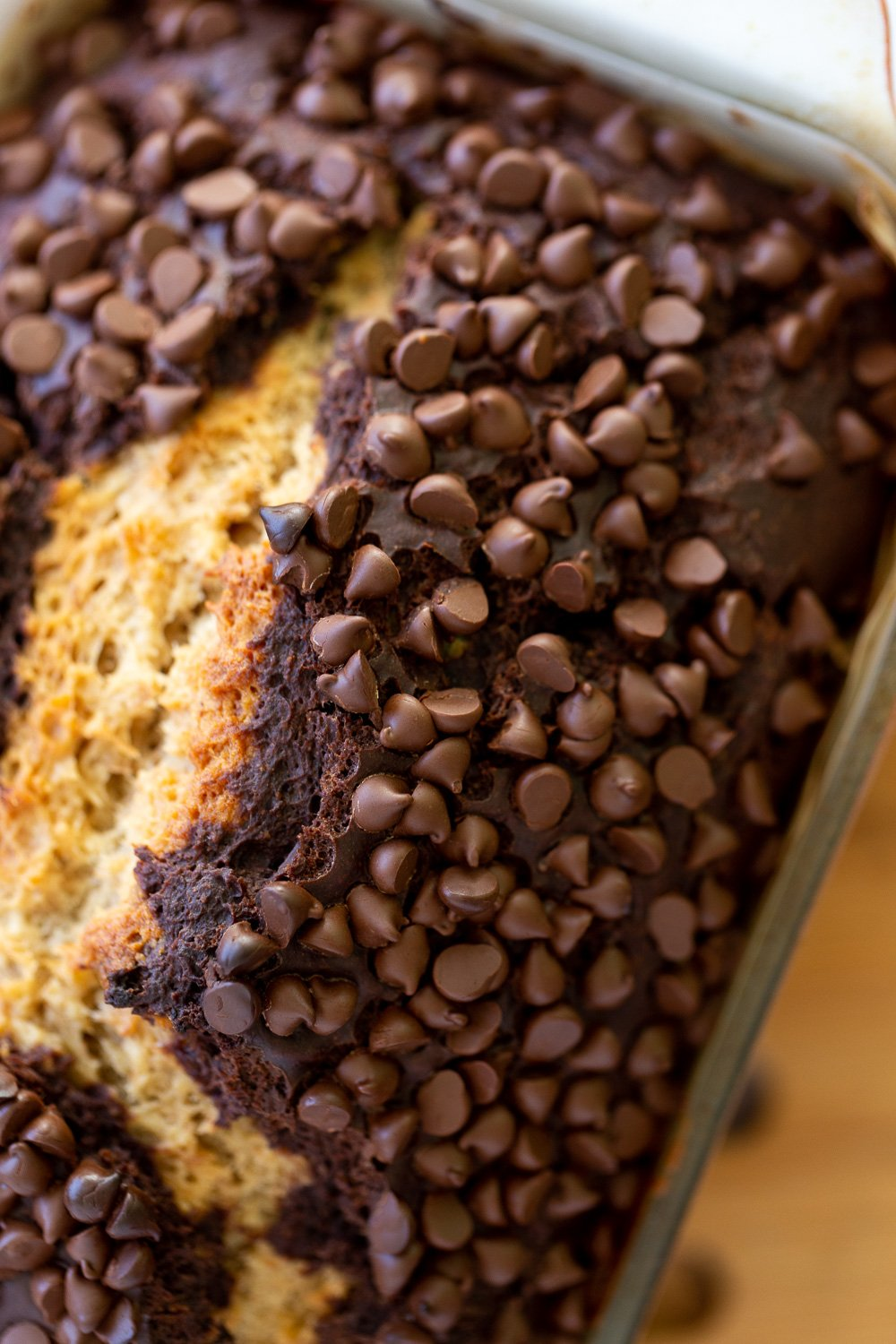 close-up overhead shot of a loaf of vegan chocolate banana bread