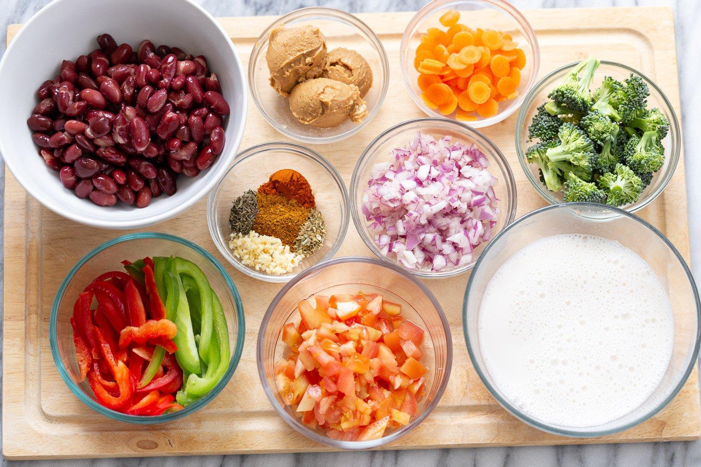 overhead shot of ingredients needed for making vegan kidney bean and peanut stew