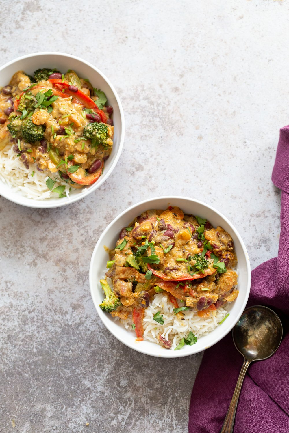 overhead shot of two bowl with vegan coconut milk based Peanut Stew served with rice