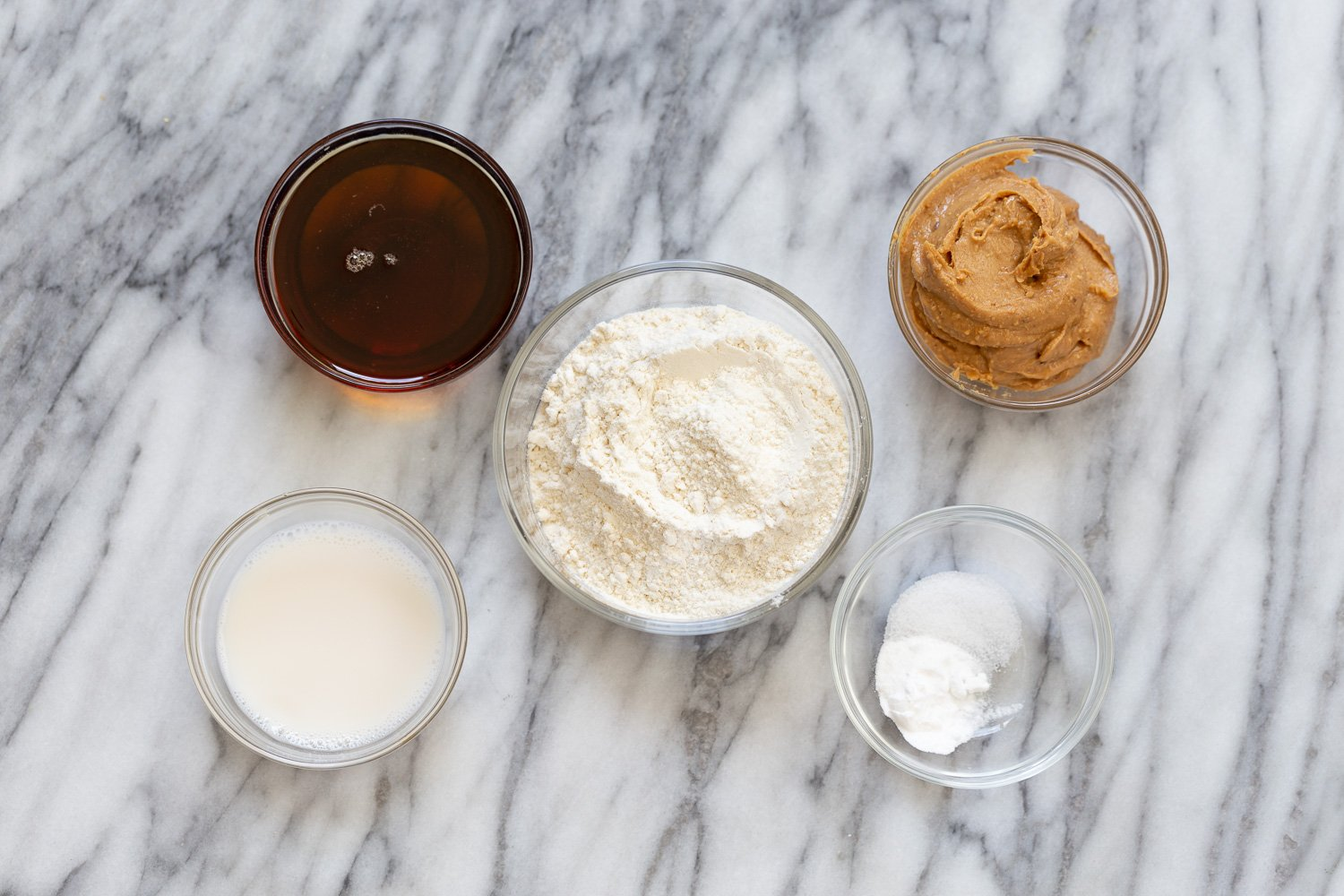 overhead shot of ingredients needed for making vegan snickers snack bars recipe
