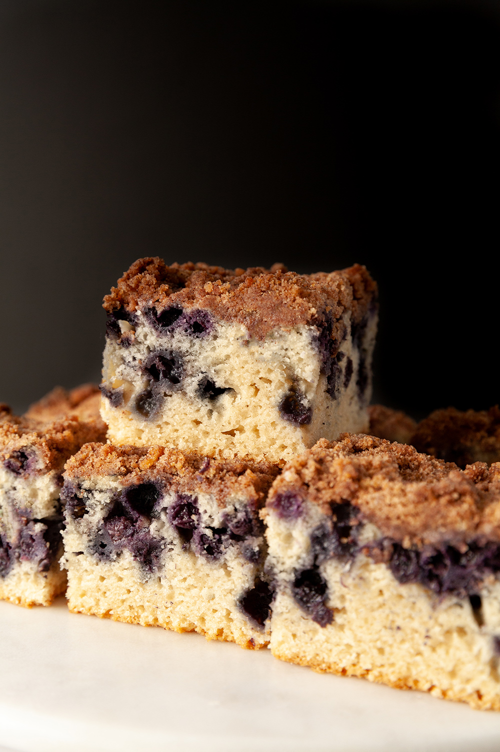 eggless lemon blueberry sheet cake against a black background