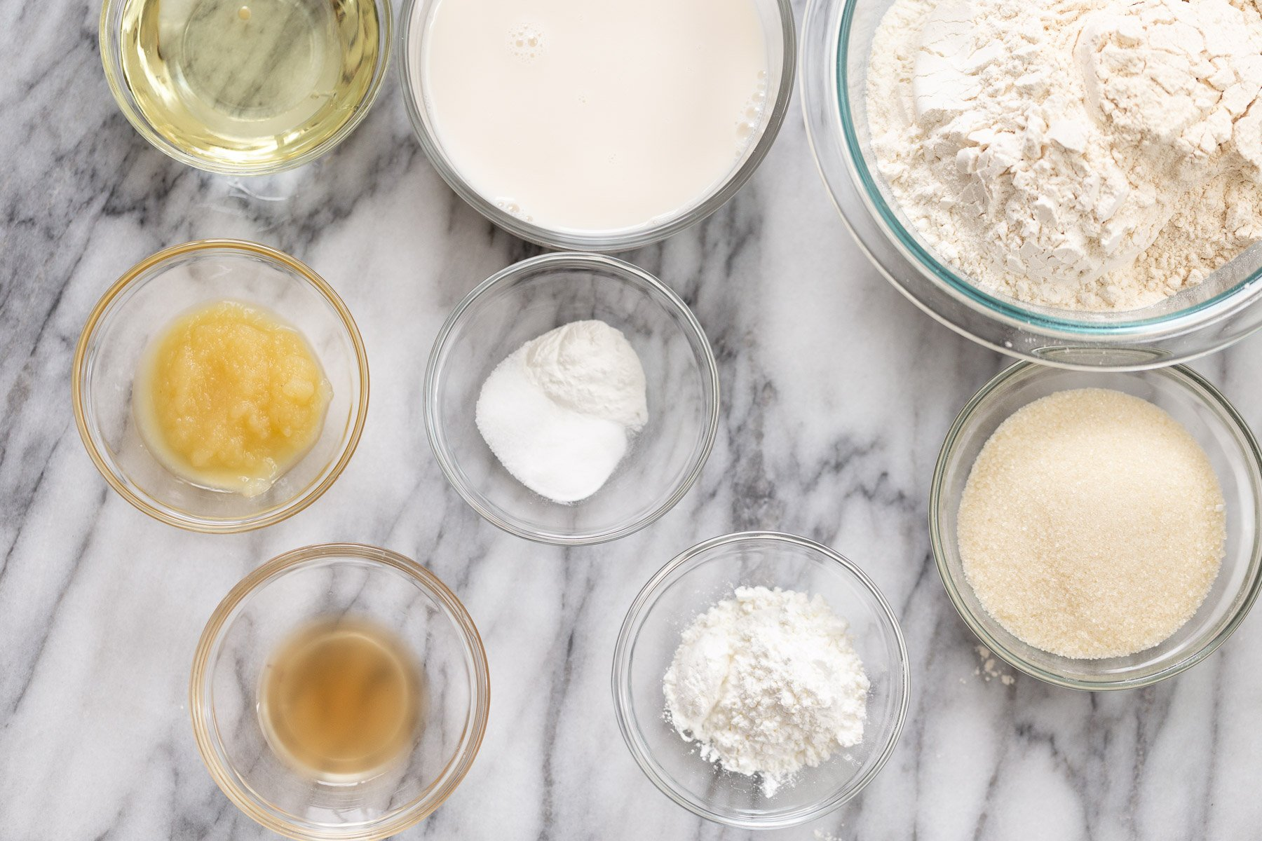 ingredients for making vegan white cake on a marble kitchen counter