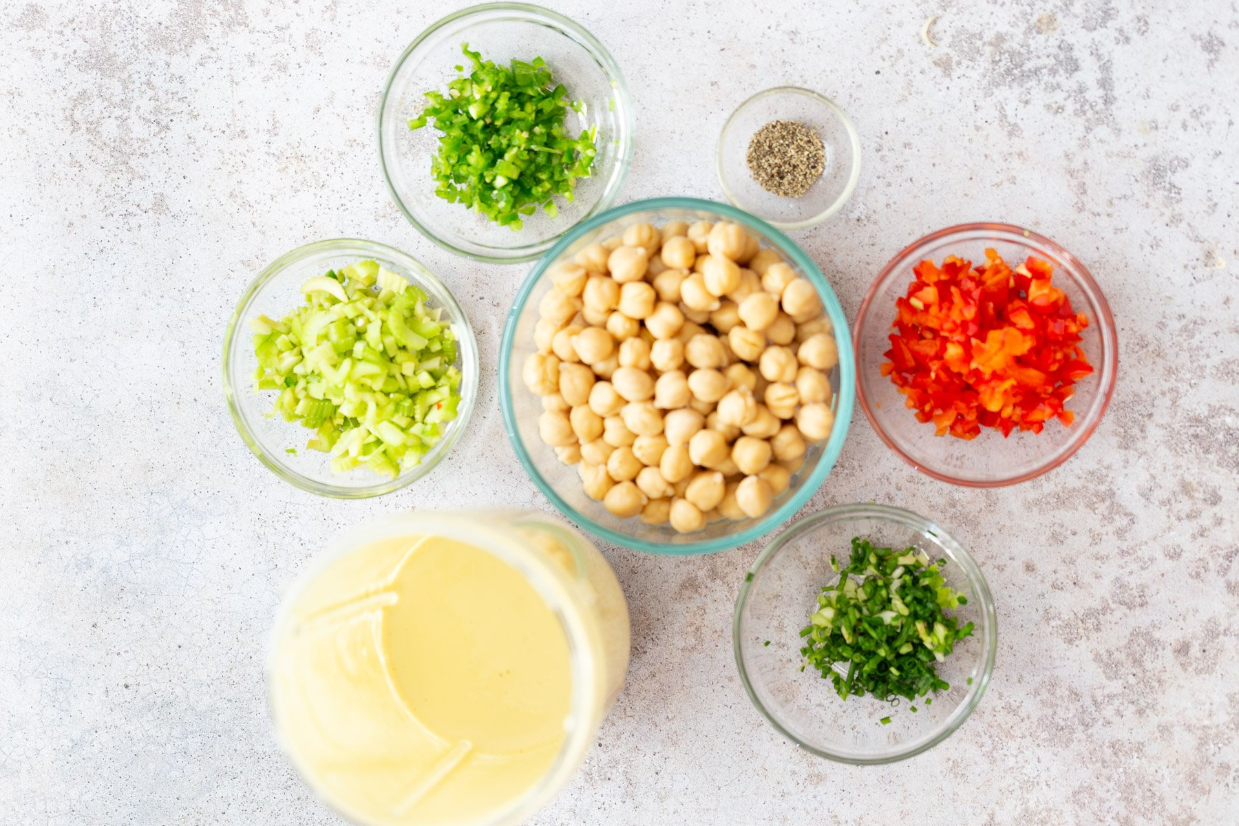 overhead shot of ingredients needed for making vegan chickpea salad