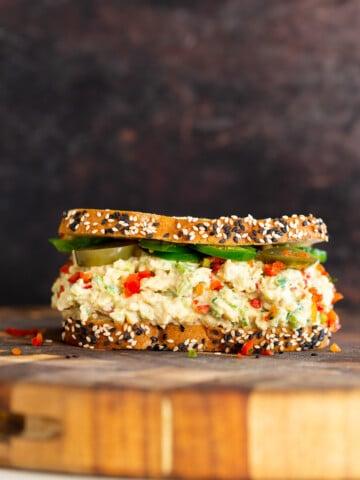 jalapeño popper chickpea salad sandwich on a chopping board