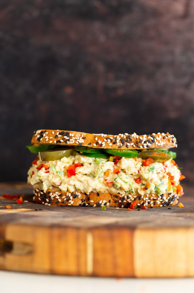 jalapeño popper chickpea salad sandwich on a chopping board