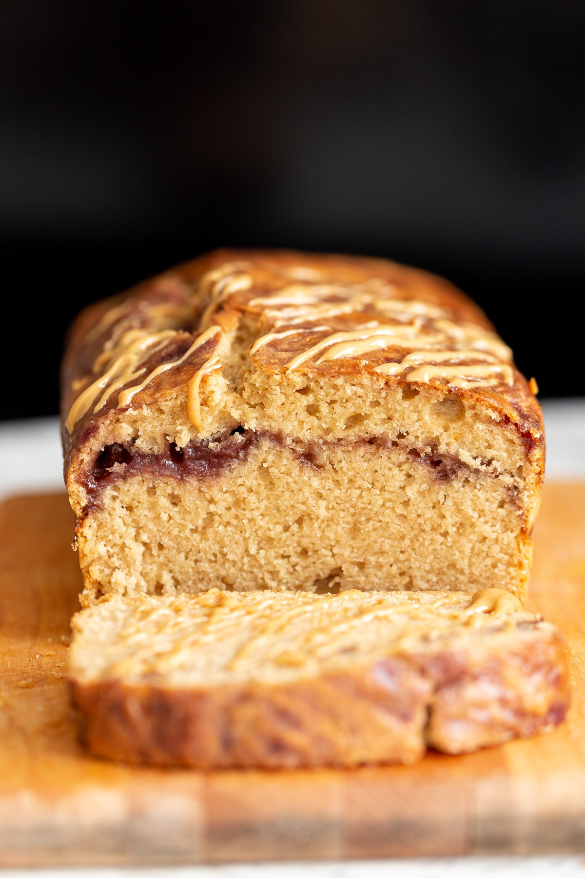 a sliced vegan peanut butter and jelly cake baked in a loaf pan