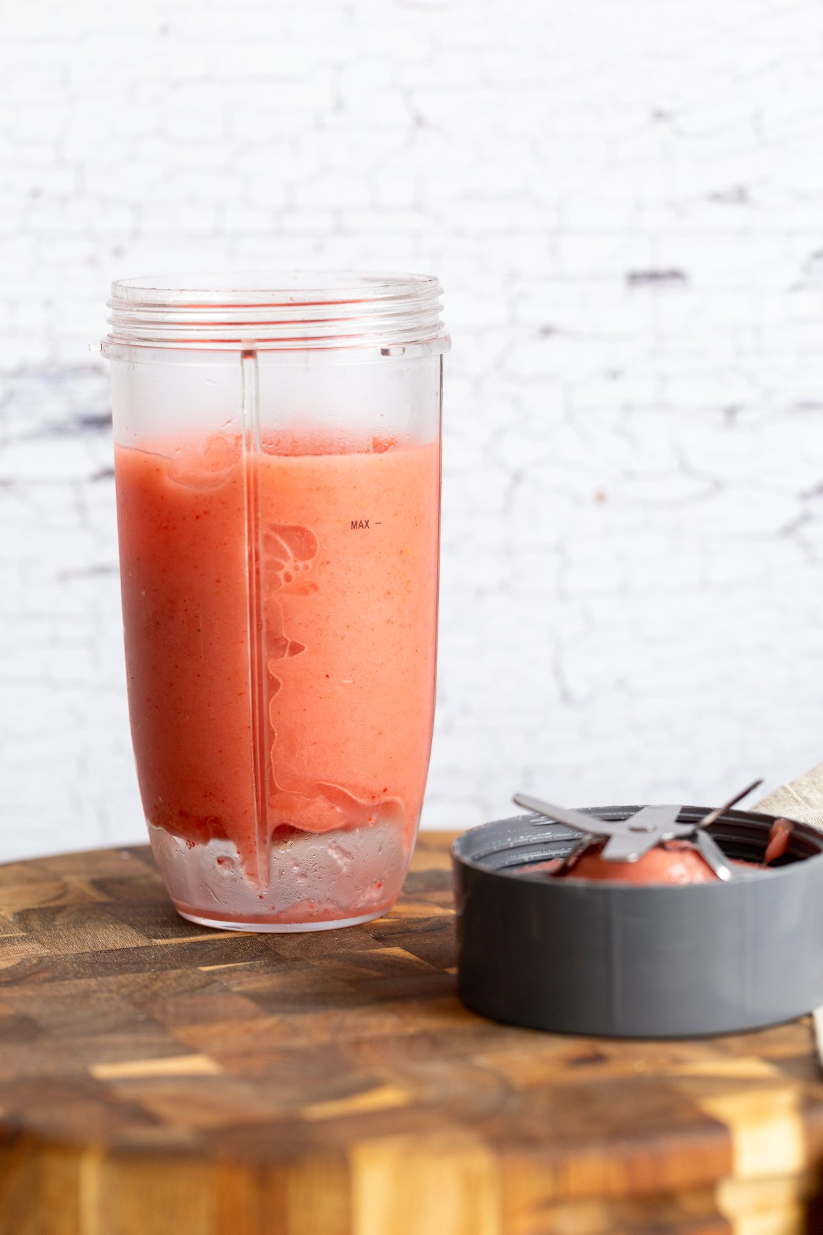 frozen strawberry lemonade slushie in a blender