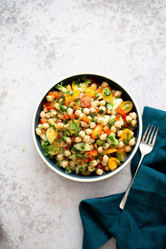 Balela Salad with a fork and blue cloth napkin
