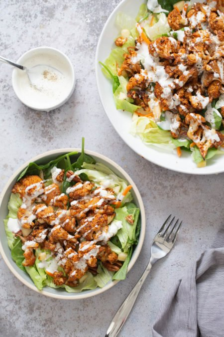 bbq roasted cauliflower salad bowl drizzled with Vegan Ranch Dressing