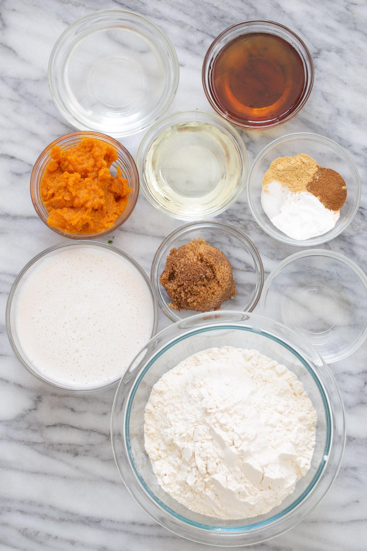 ingredients for vegan pumpkin pancakes on a marble slate