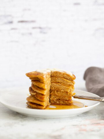 a stack of vegan pumpkin pancakes