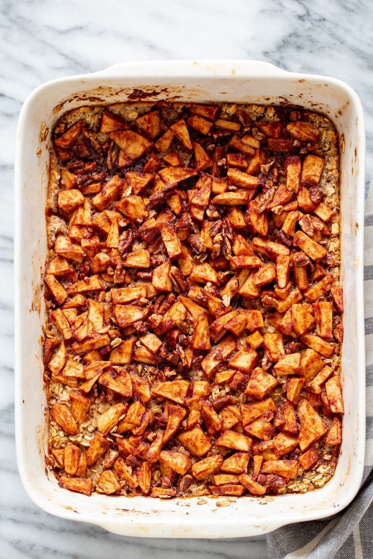overhead shot of a casserole dish with apple pie baked oatmeal