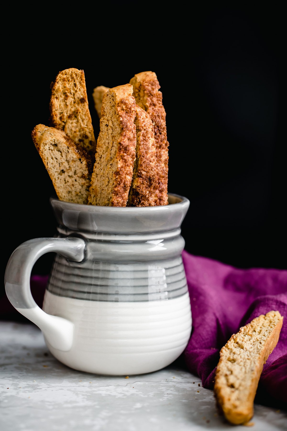 homemade vegan cinnamon sugar biscotti in a small coffee mug
