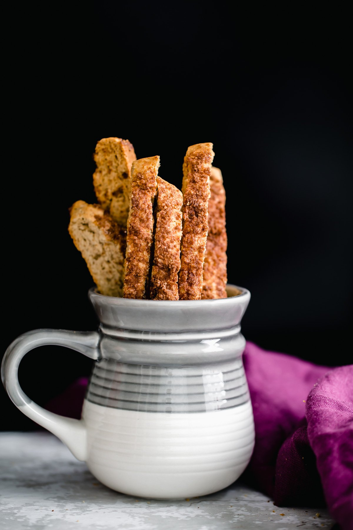 a coffee mug with vegan cinnamon sugar biscotti
