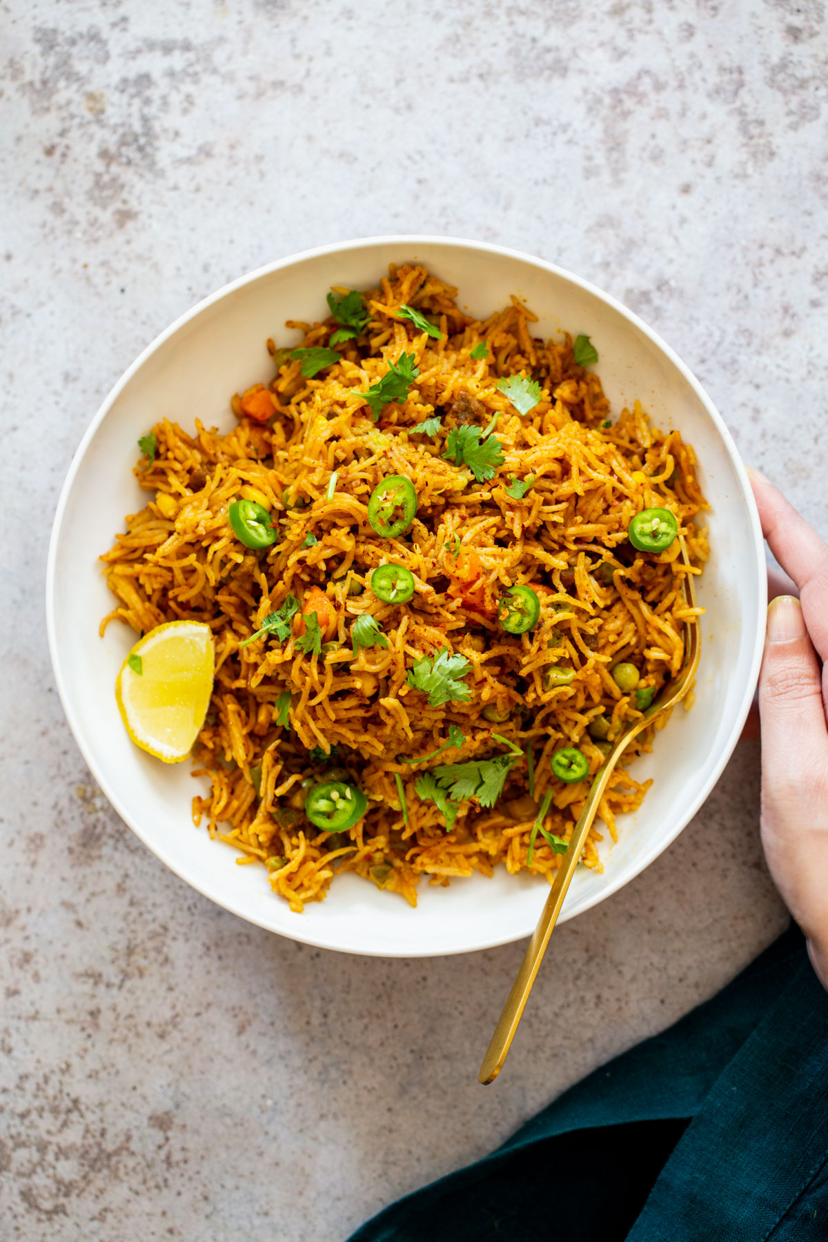 pumpkin fried rice served with sliced of lime and jalapenos