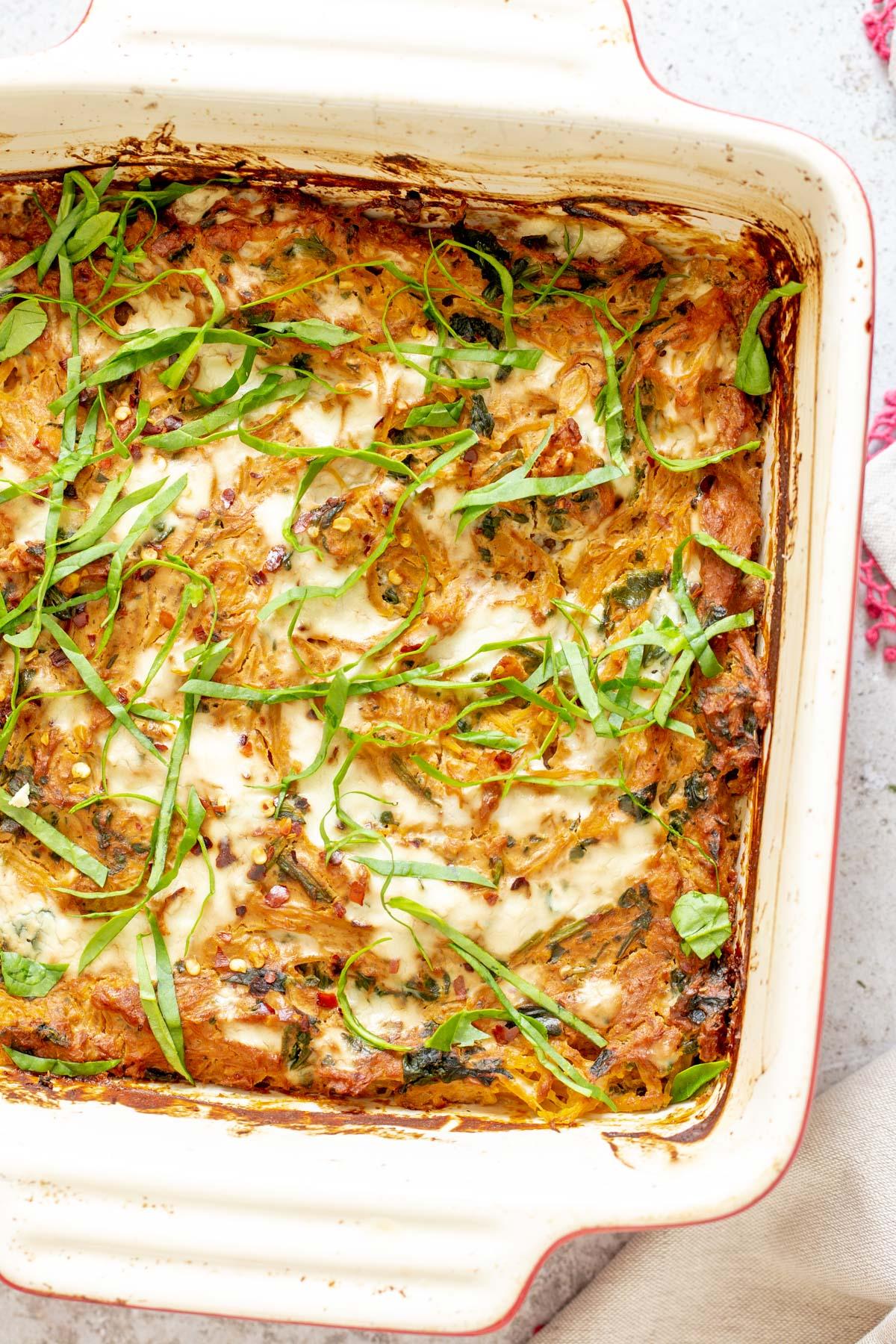 vegan Italian Sun-dried tomato Spaghetti Squash Pasta Bake in a white casserole dish