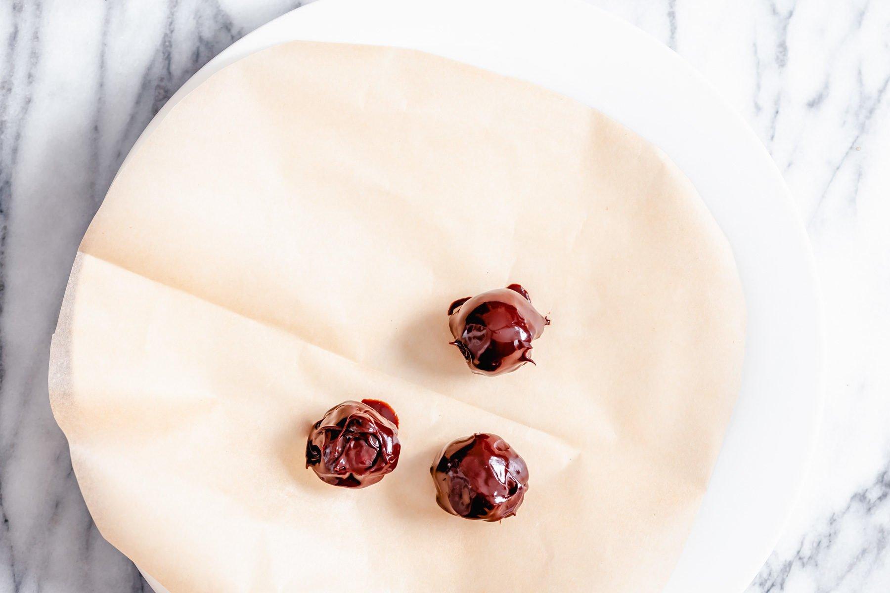 overhead shot of a plate with freshly coated vegan tiramisu truffles