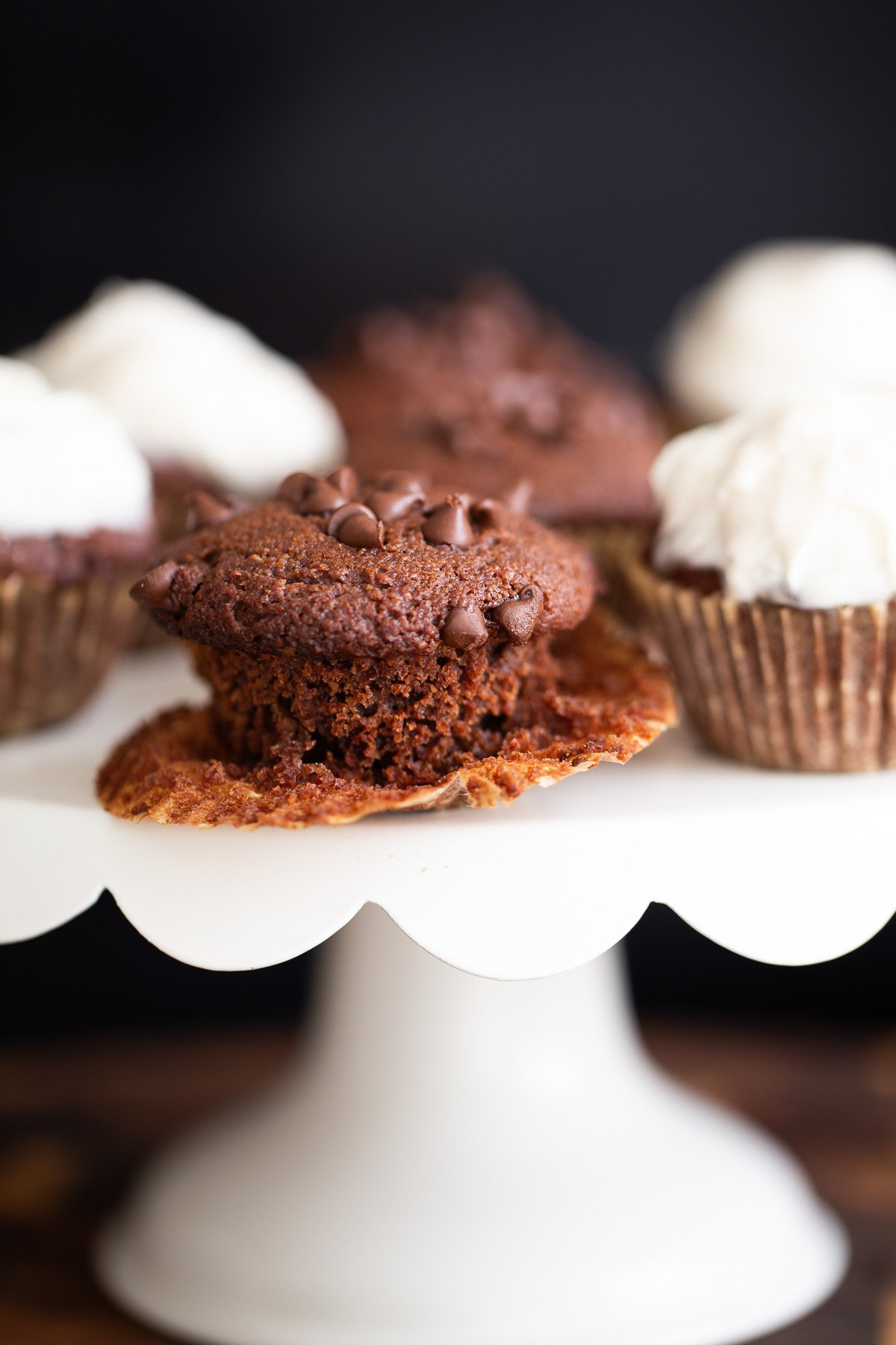 vegan chocolate cupcakes on a white cake stand