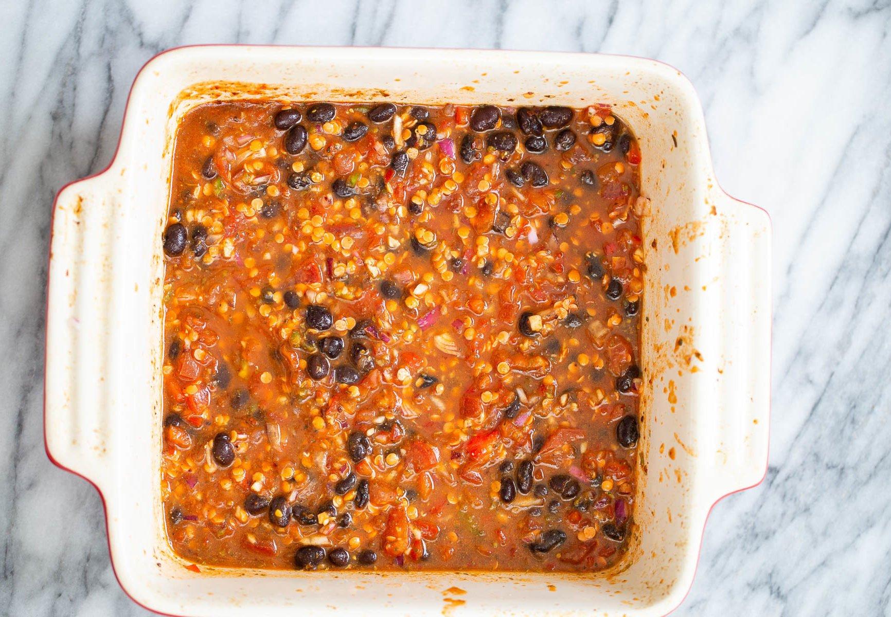 chili mix in white casserole dish for cornbread casserole