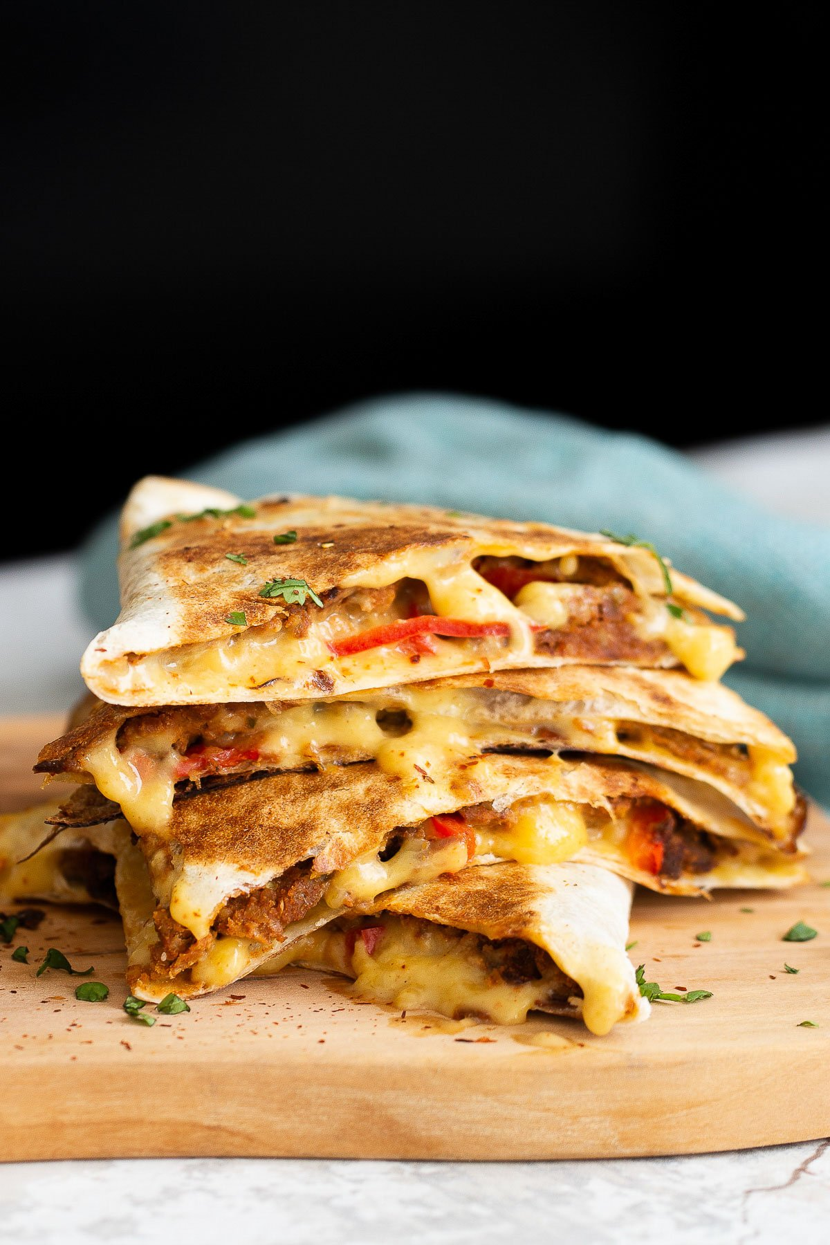 close-up side view of a stack of cut vegan walnut meat quesadillas