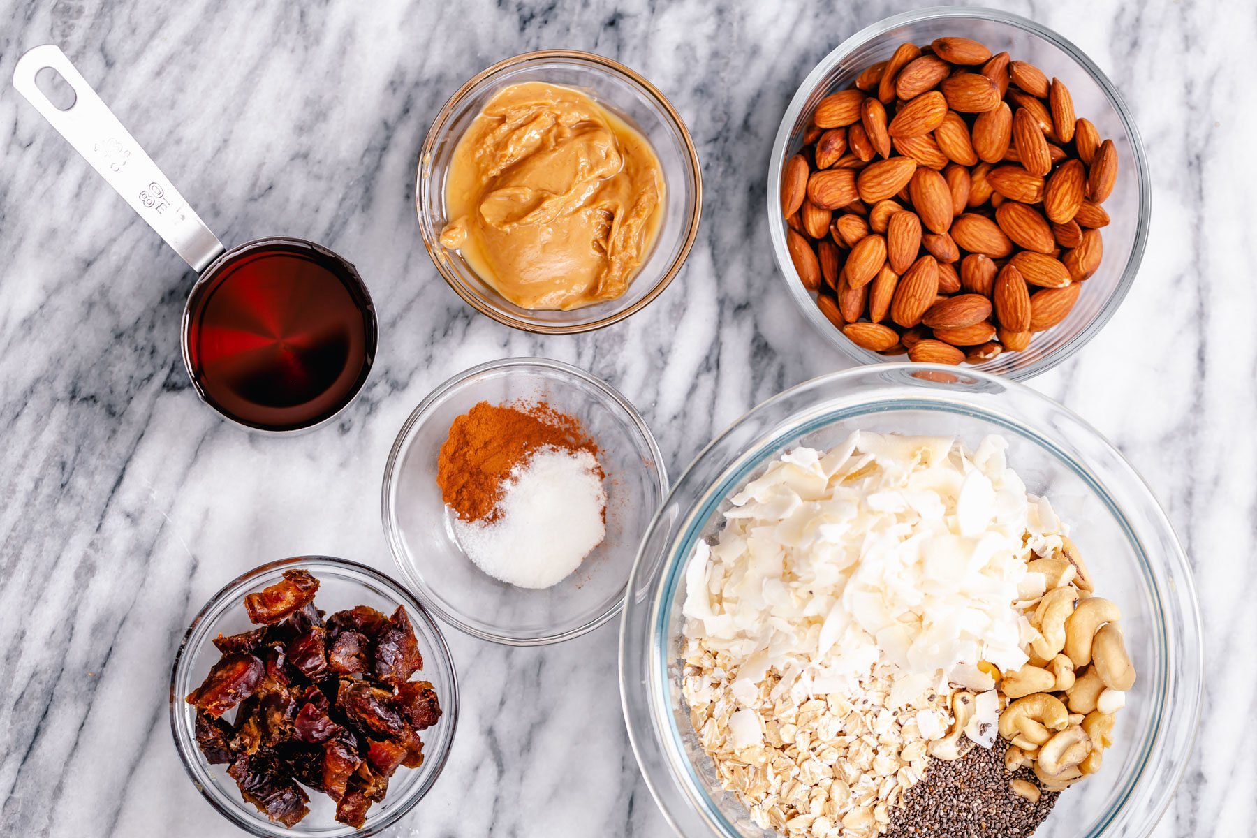 overhead shot of ingredients needed for making almond coconut granola