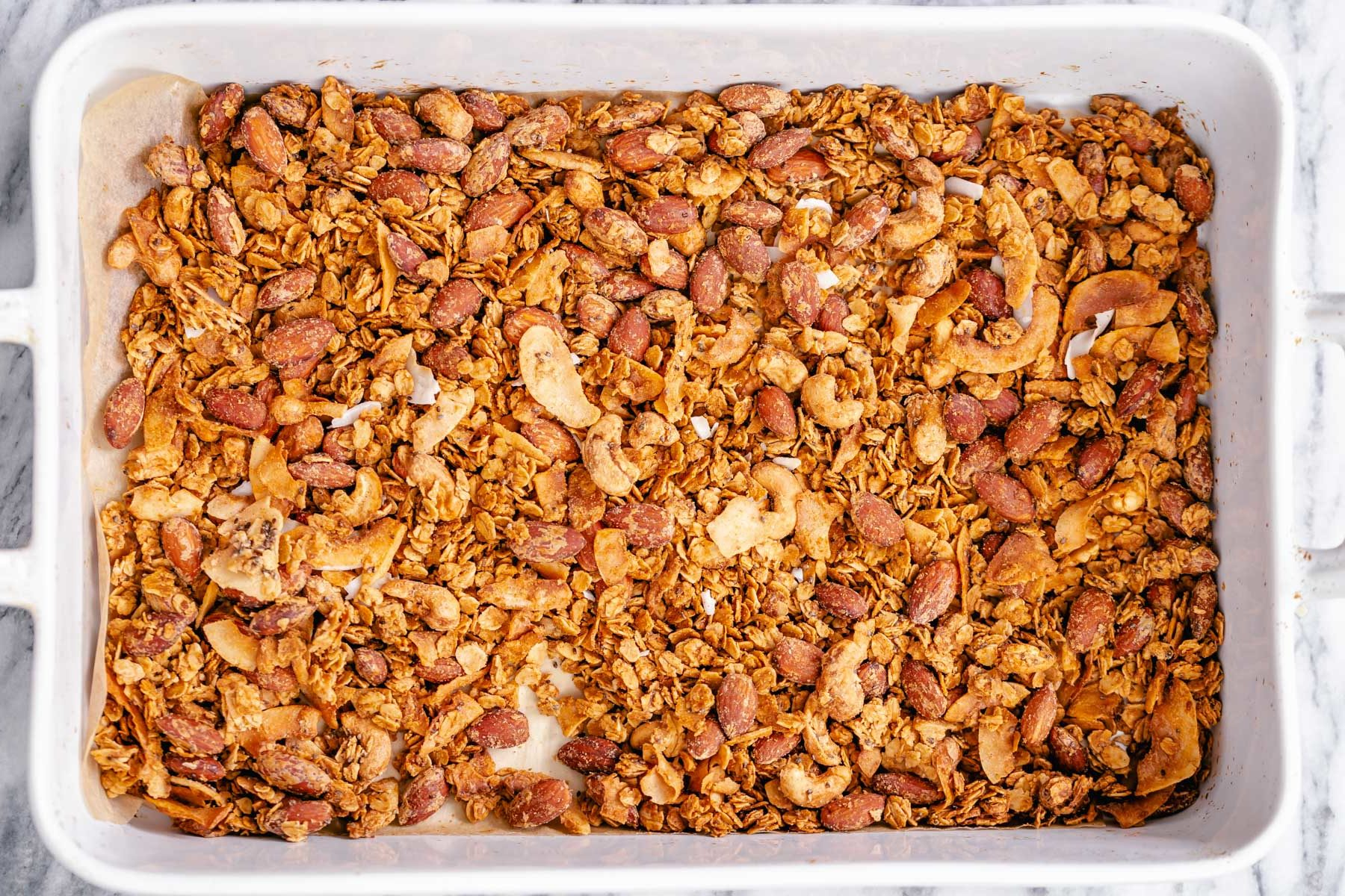 a white casserole dish filled with baked vegan granola