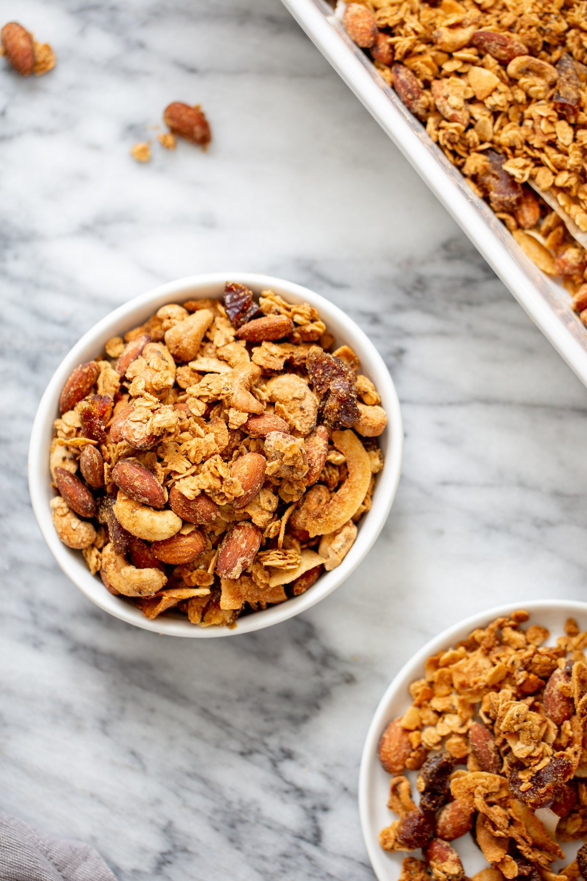 two small bowls of homemade almond coconut granola
