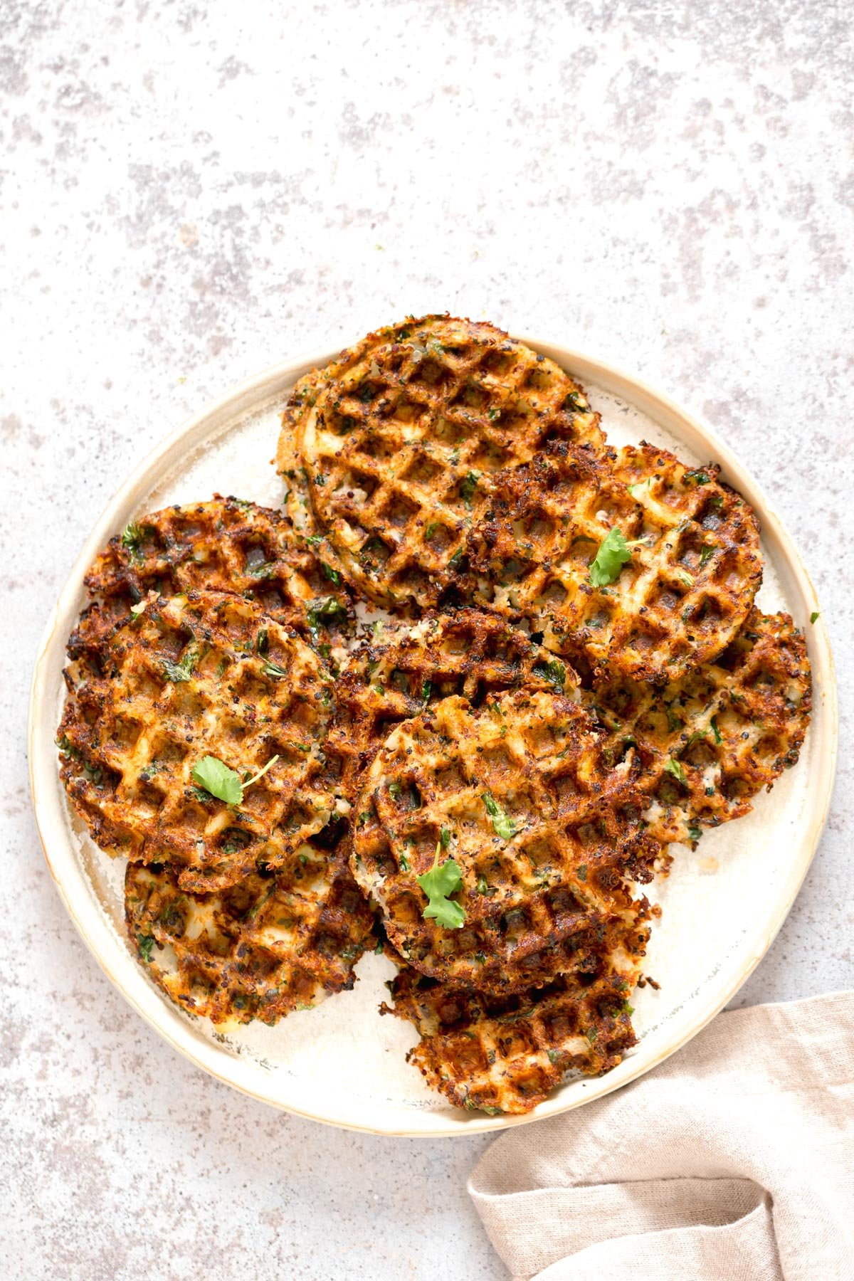 a plate of crispy vegan potato quinoa waffles