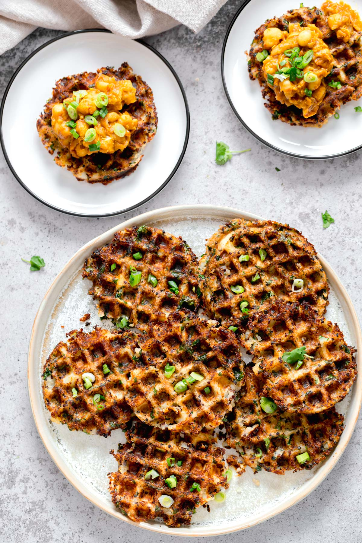 overhead shot of vegan potato quinoa waffles sprinkled with chopped chives