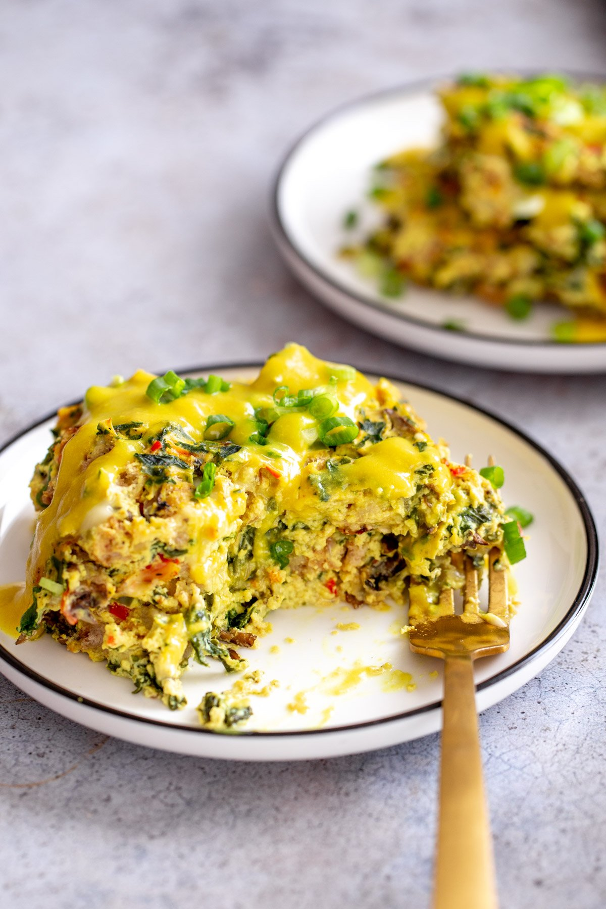 vegan egg casserole on a small plate served with vegan hollandaise sauce