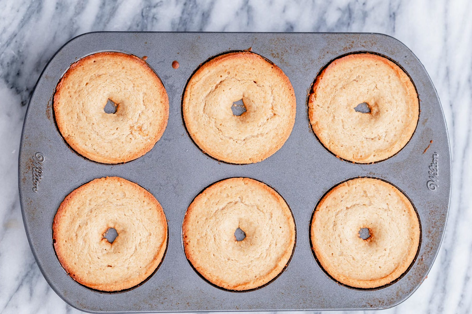freshly baked glutenfree donuts in a baking pan