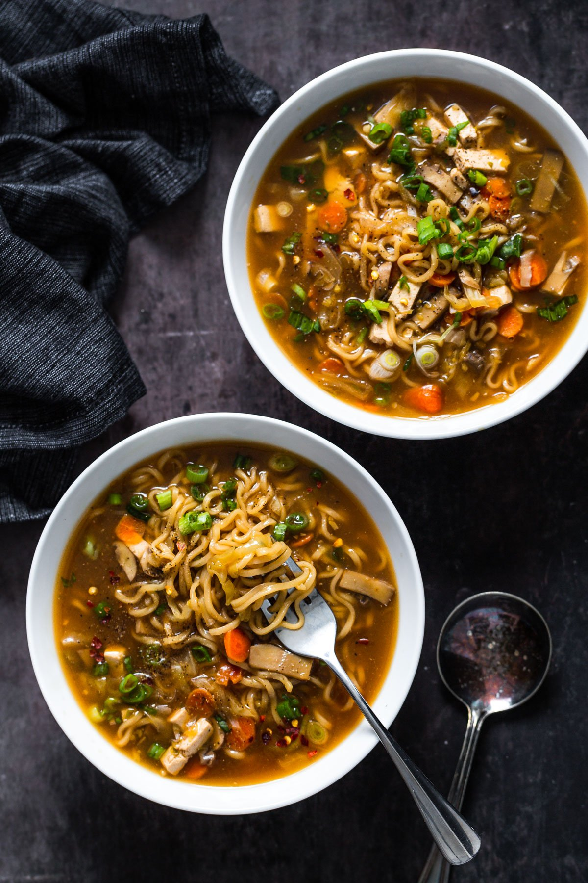 overhead shot of two bowl of Chinese Hot and Sour Soup with Ramen noodles served in two soup bowls