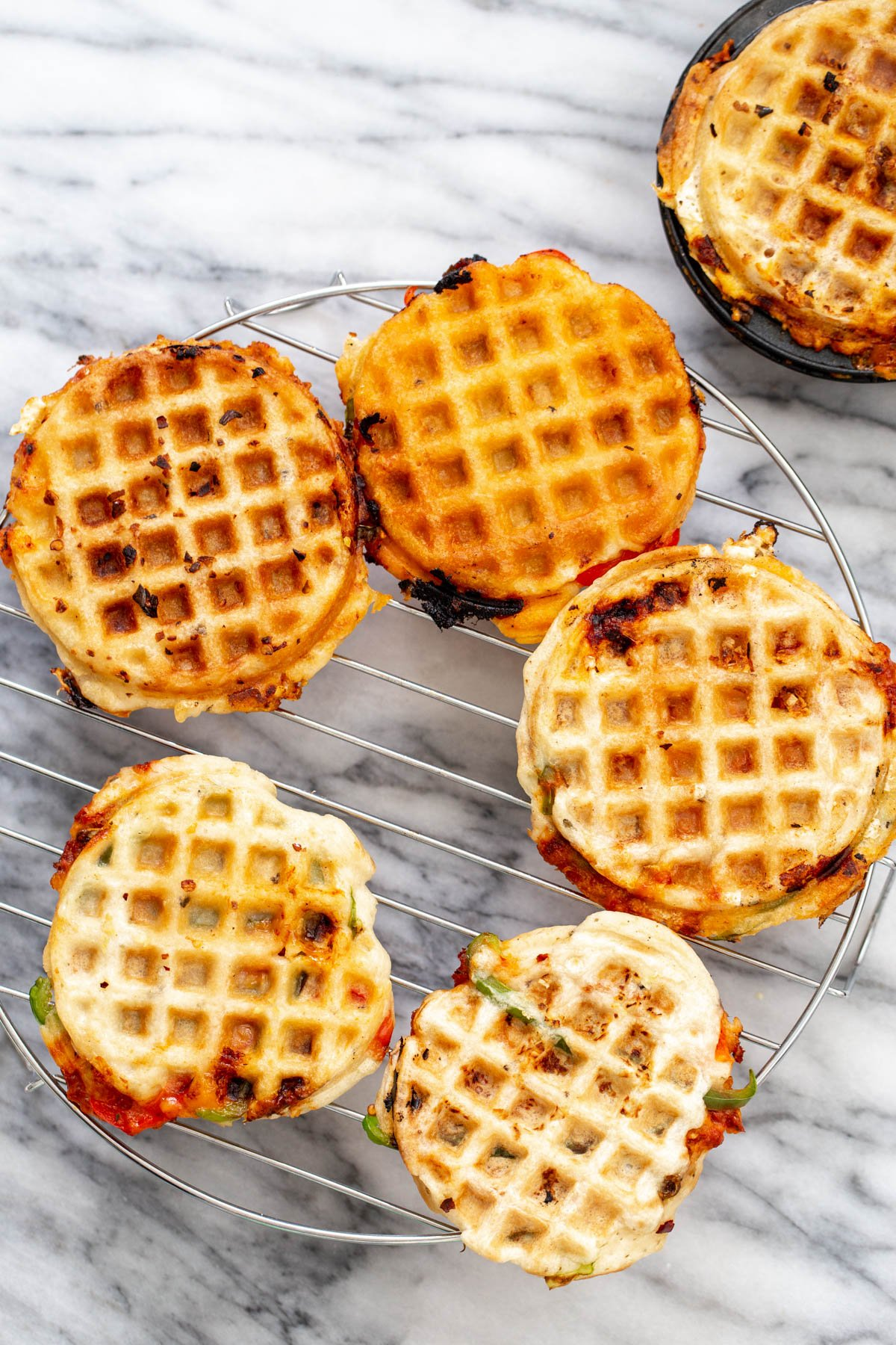 vegan pizza waffles chilling on a grid