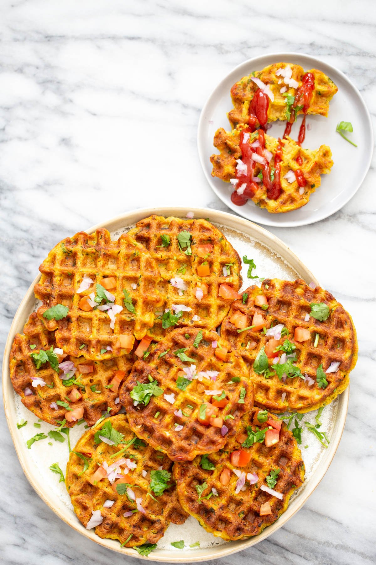 overhead shot of a plate with crispy vegan chickpea flour waffles with vegetables