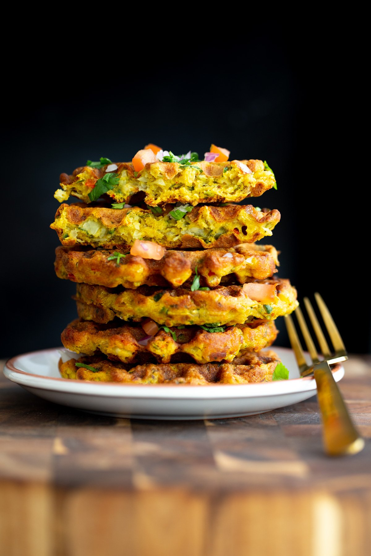 a stack of vegan savory chickpea flour waffles