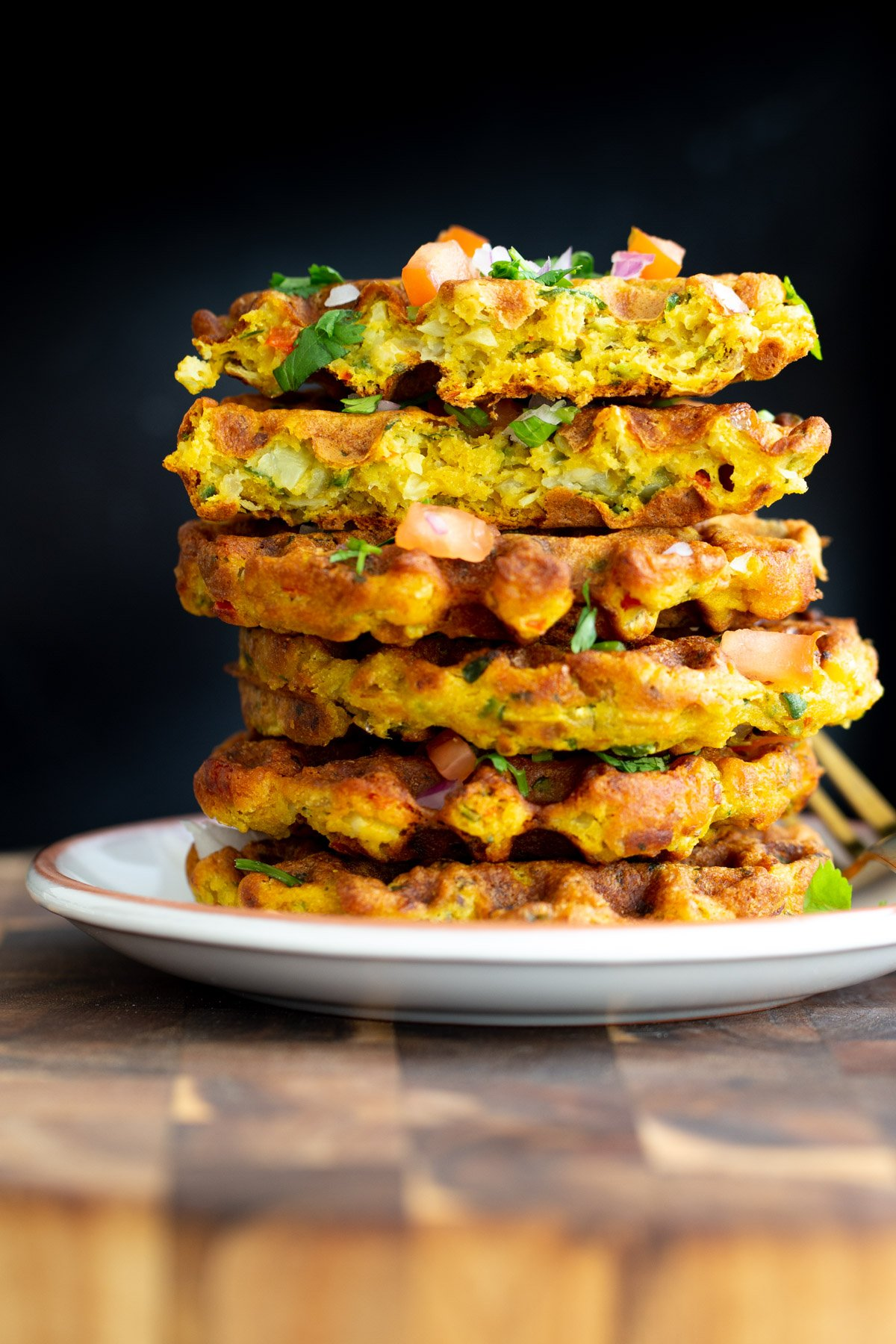 stacked vegan chickpea flour waffles against a black background
