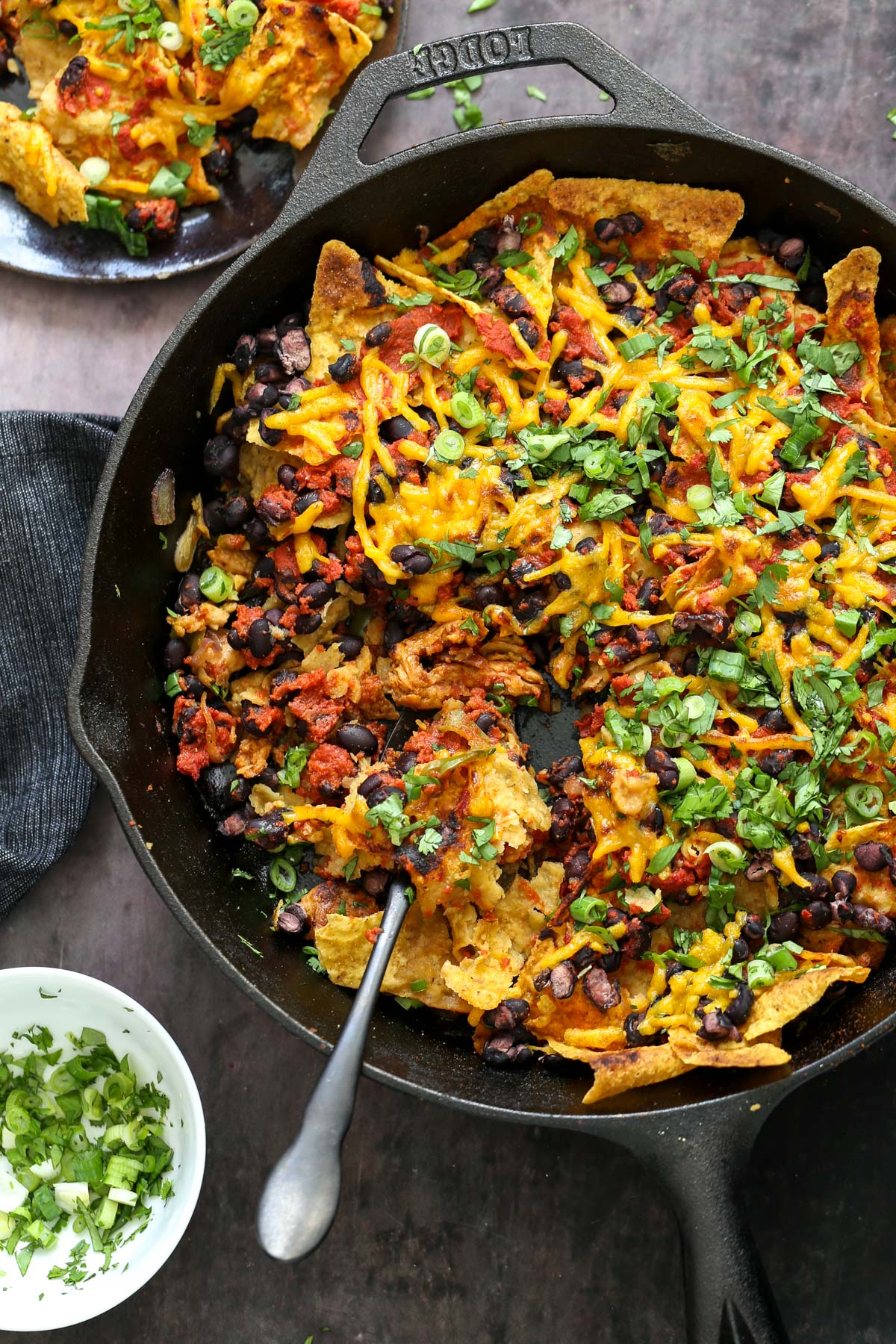 vegan skillet enchiladas with a spoon