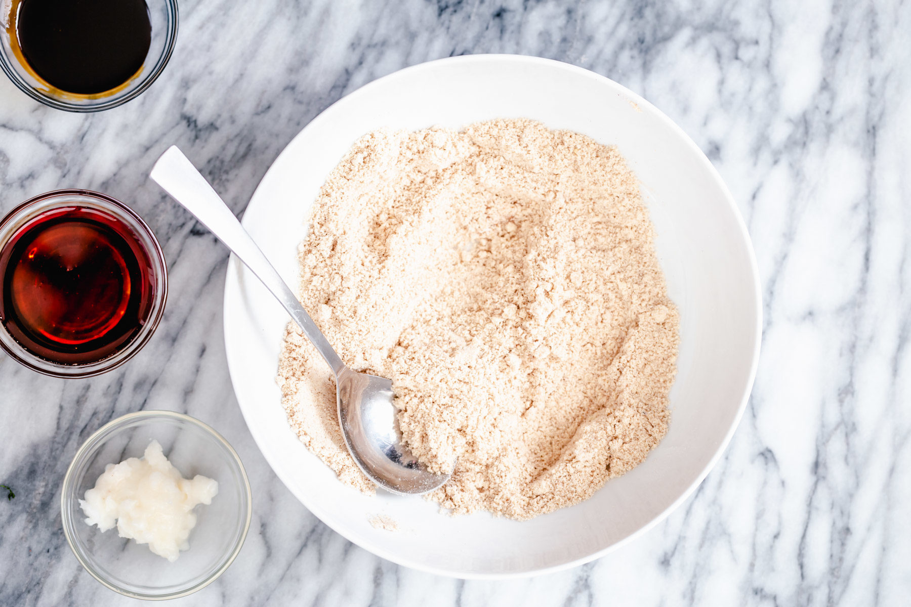vegan gingerbread cookie batter mix in a small white bowl