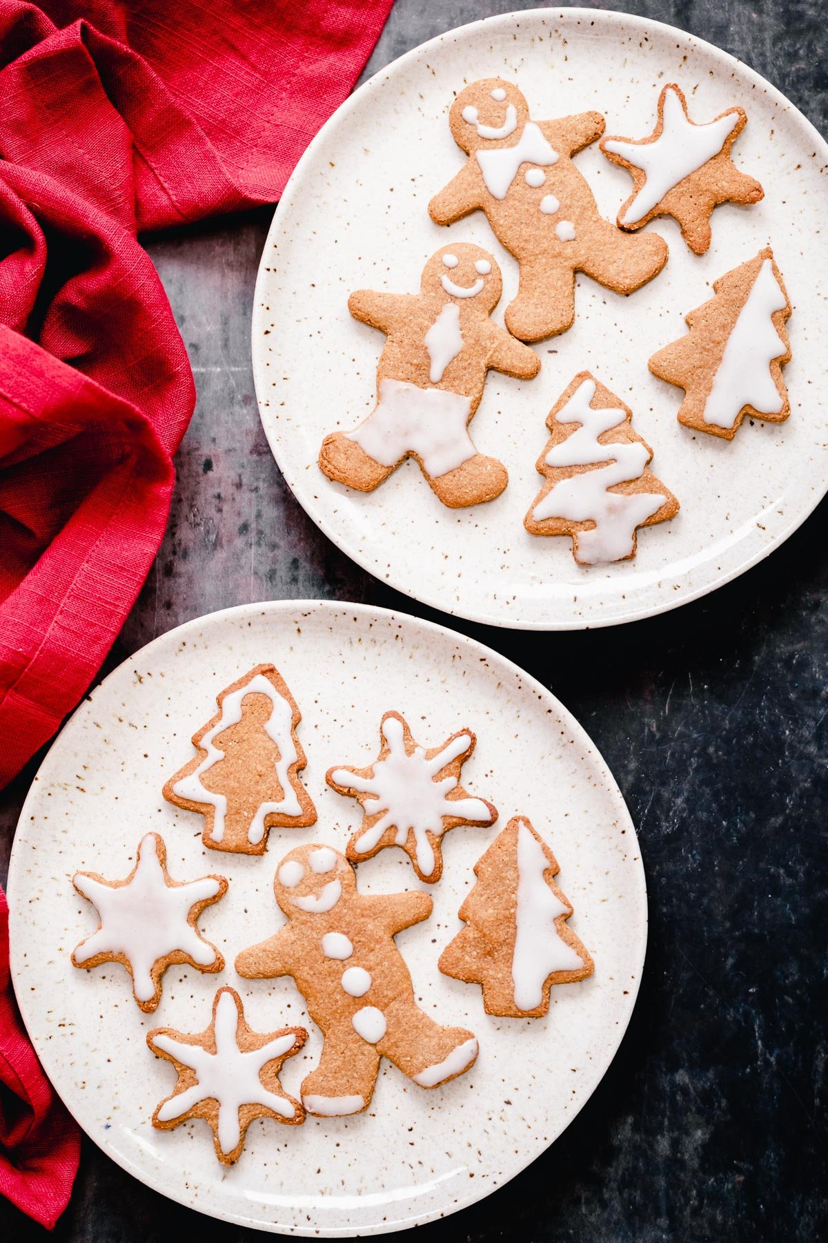 overhead shot of two plates of gluten-free grain-free holiday gingerbread cookies