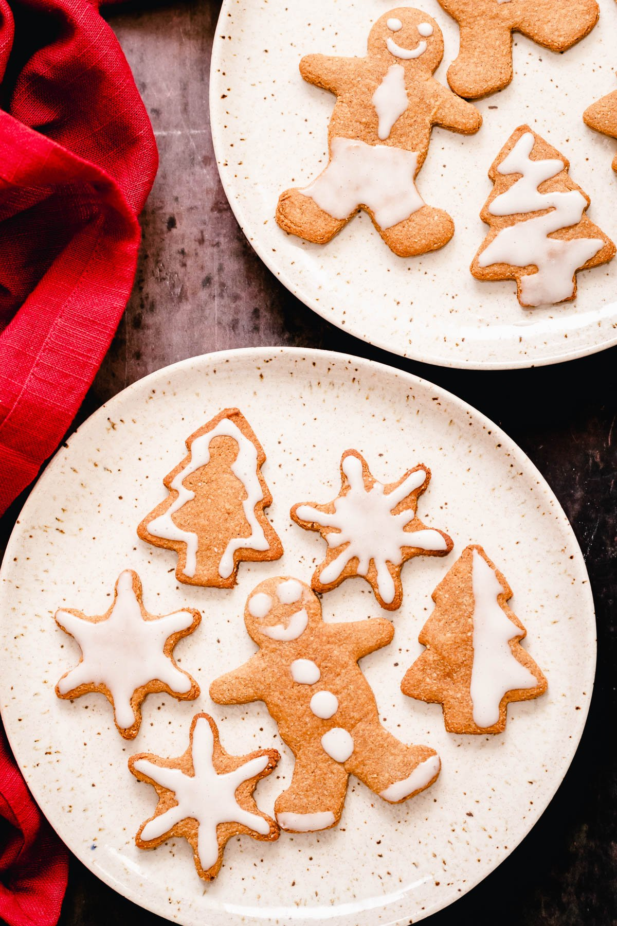 two plates with iced glutenfree vegan gingerbread cookies