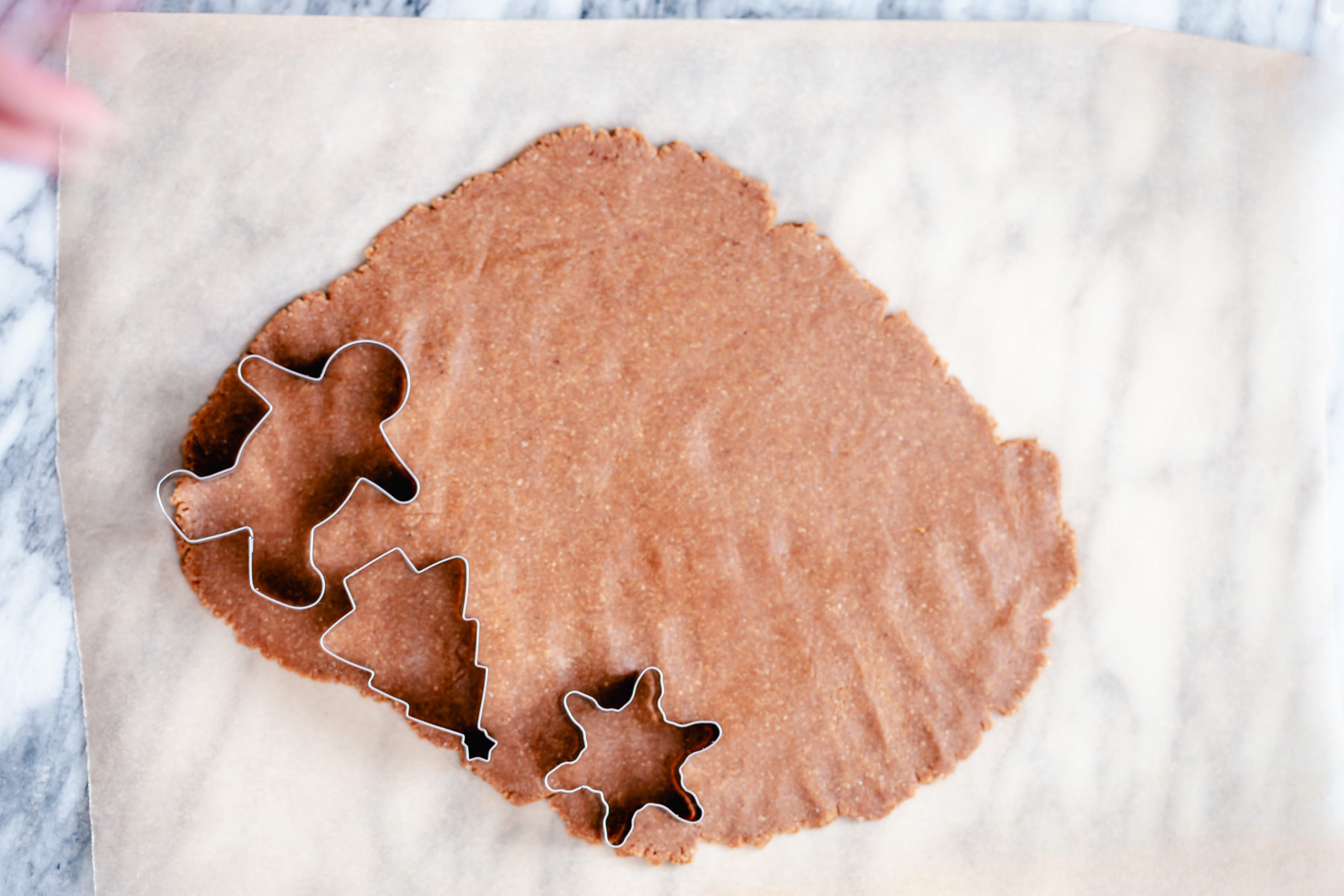 vegan gingerbread cookies being cut out