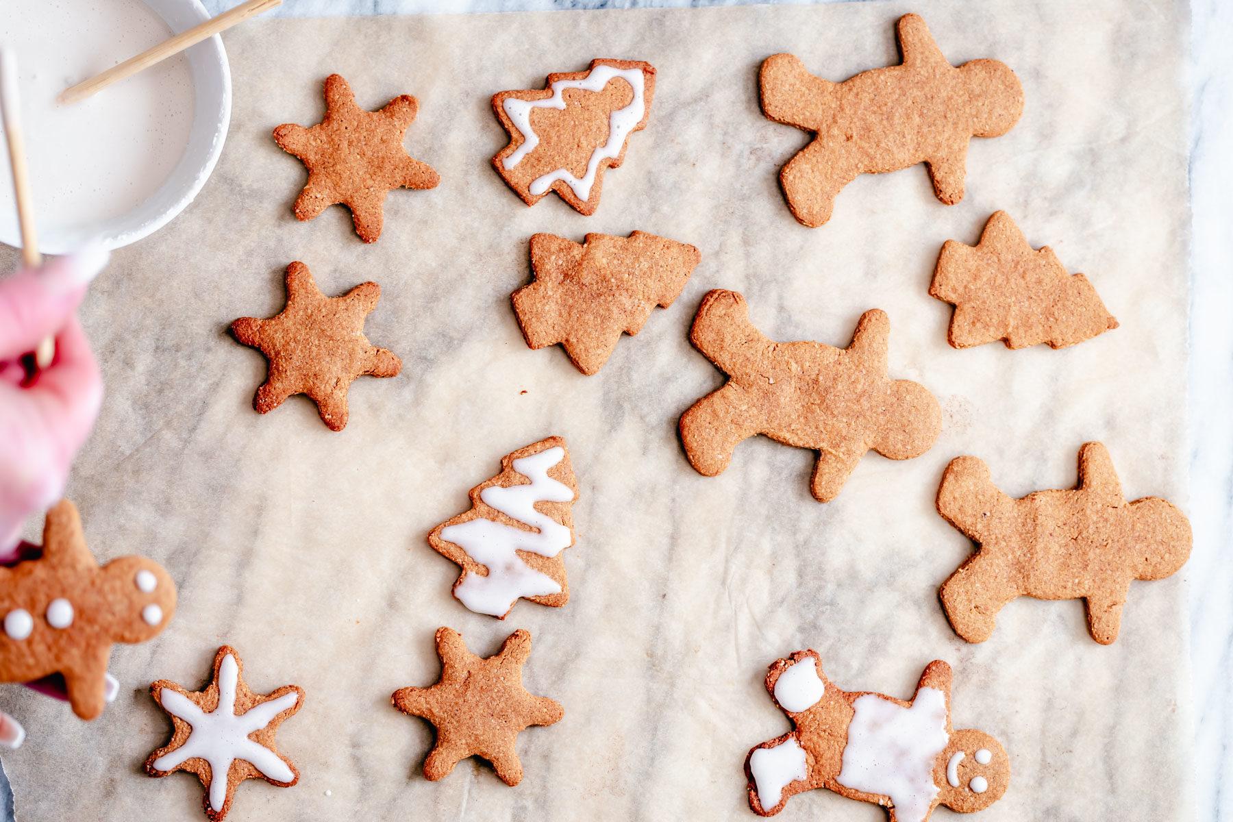 vegan gingerbread cookies being iced