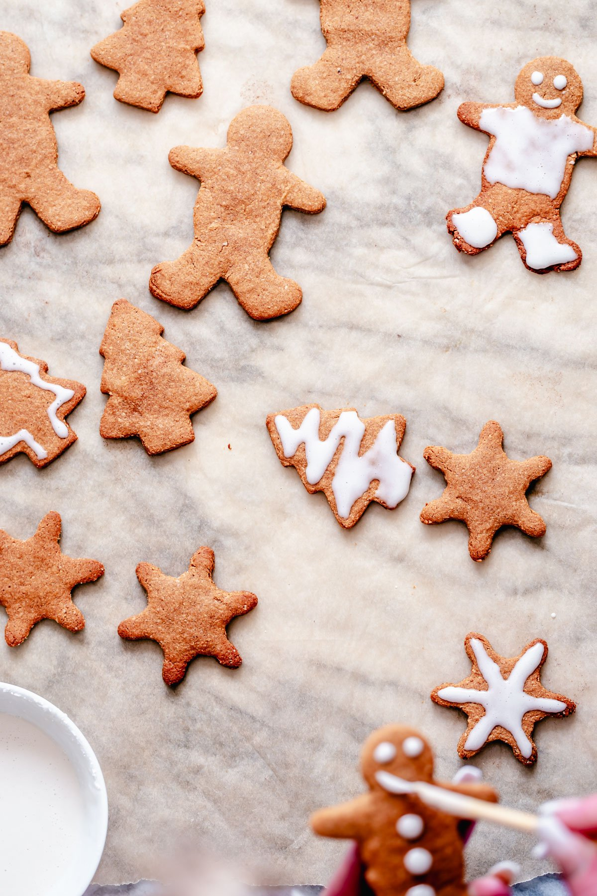 iced vegan spiced gingerbread cookies on a marble countertop