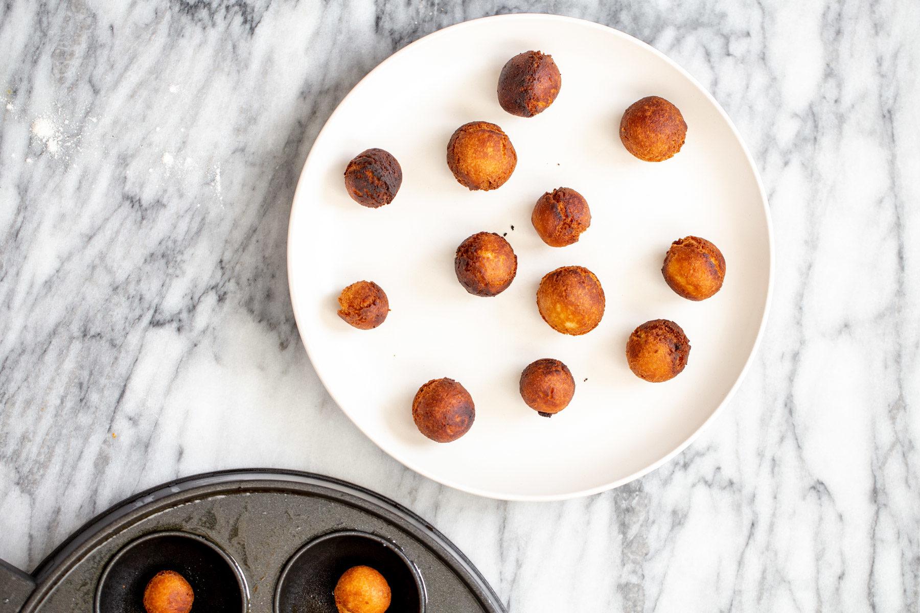 vegan gulab jamun on a white plate